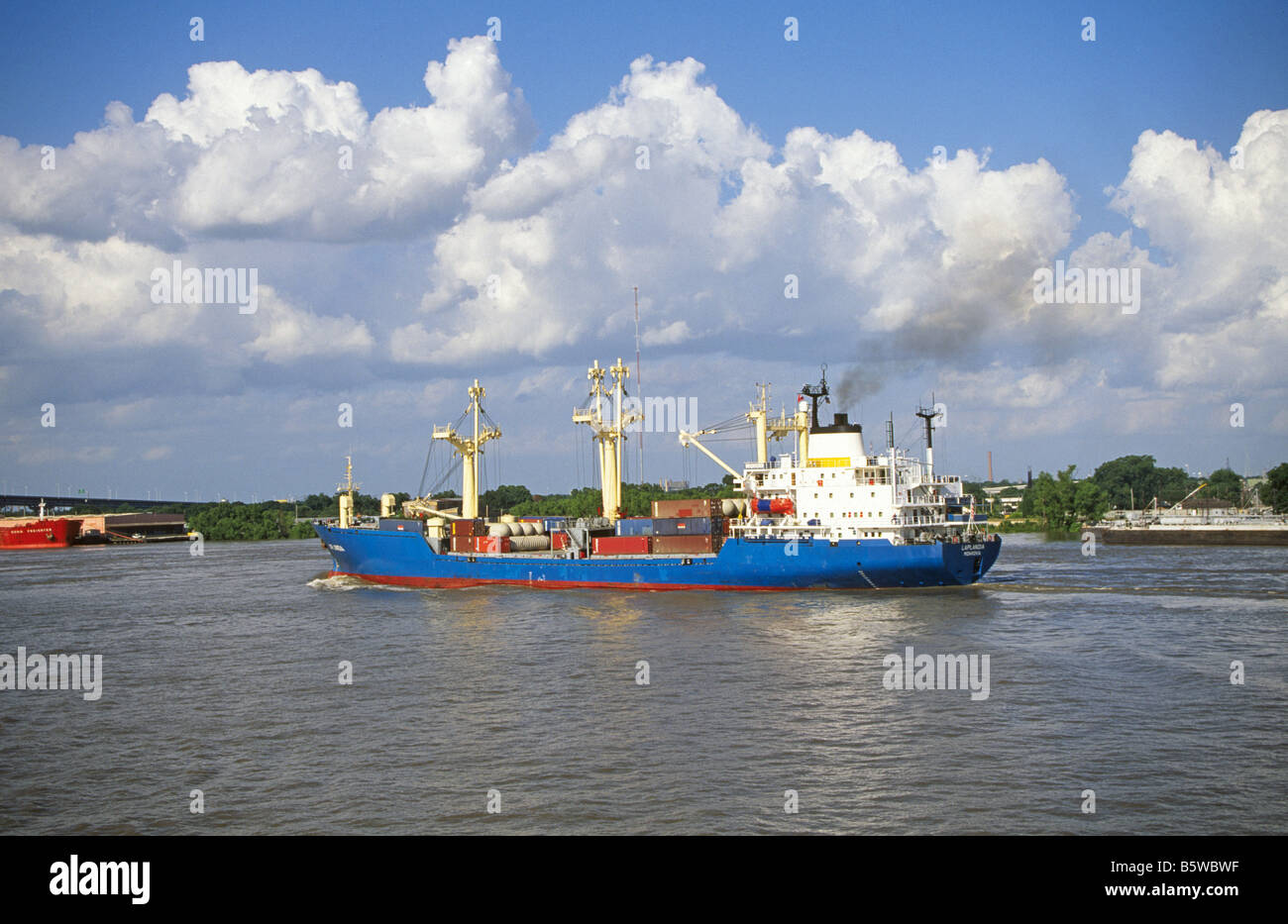 A small freighter cargo carrying ship on the Mississippi River near St Louis, Missouri. Stock Photo