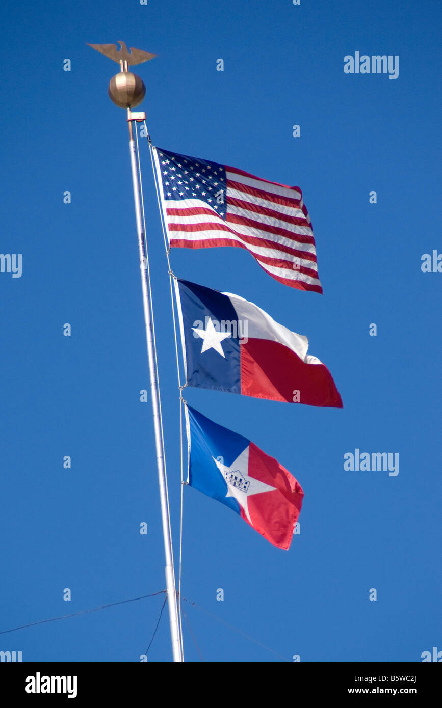 Flags of City of San Antonio, State of Texas, and USA (from bottom to top) - Stock Image