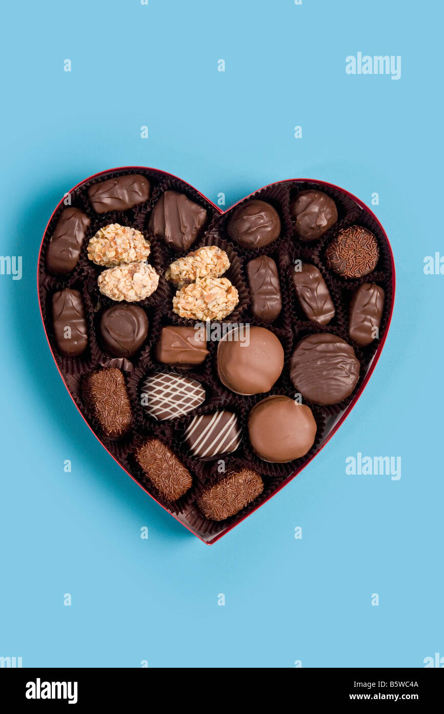 candy heart filled with chocolates for Valentine - Stock Image