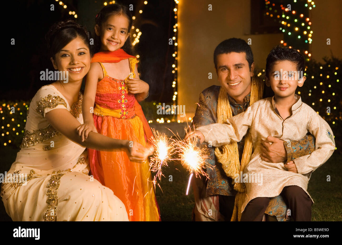 Family celebrating diwali - Stock Image