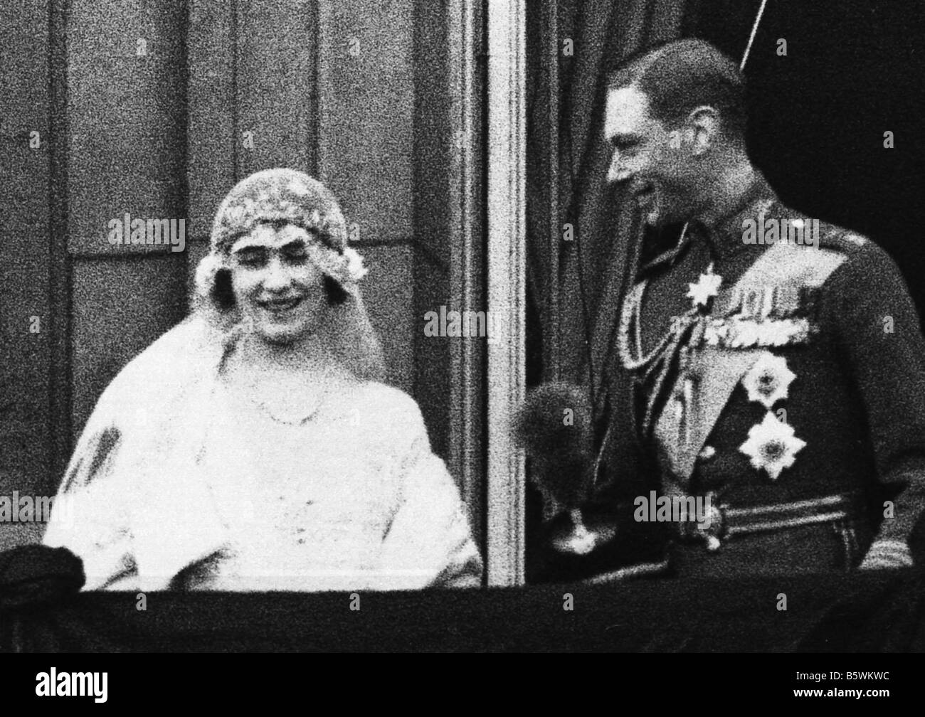 KING GEORGE VI  in 1923 as Duke of York he married Lady Elizabeth Bowes-Lyon. Here they pose on the balcony of Buckingham - Stock Image
