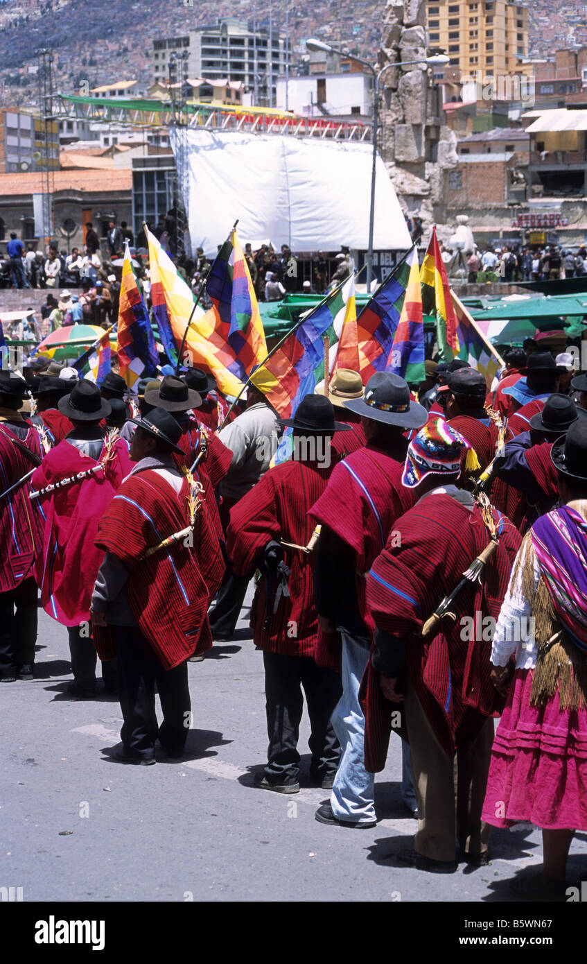 Indigenous Aymara people dressed in red ponchos during protest march in central La Paz , Bolivia. - Stock Image