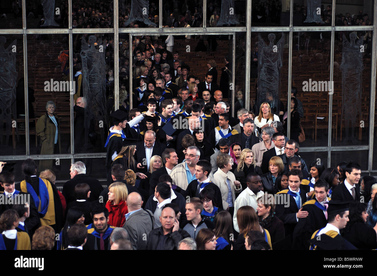 People leaving Coventry Cathedral after Coventry University graduation ceremony, West Midlands, England, UK - Stock Image