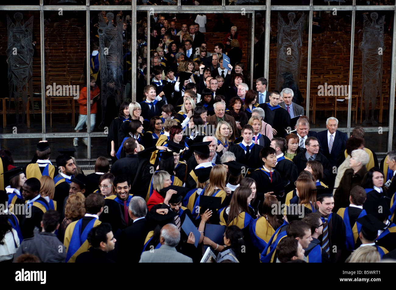 People leaving Coventry Cathedral after Coventry University graduation ceremony, West Midlands, UK - Stock Image