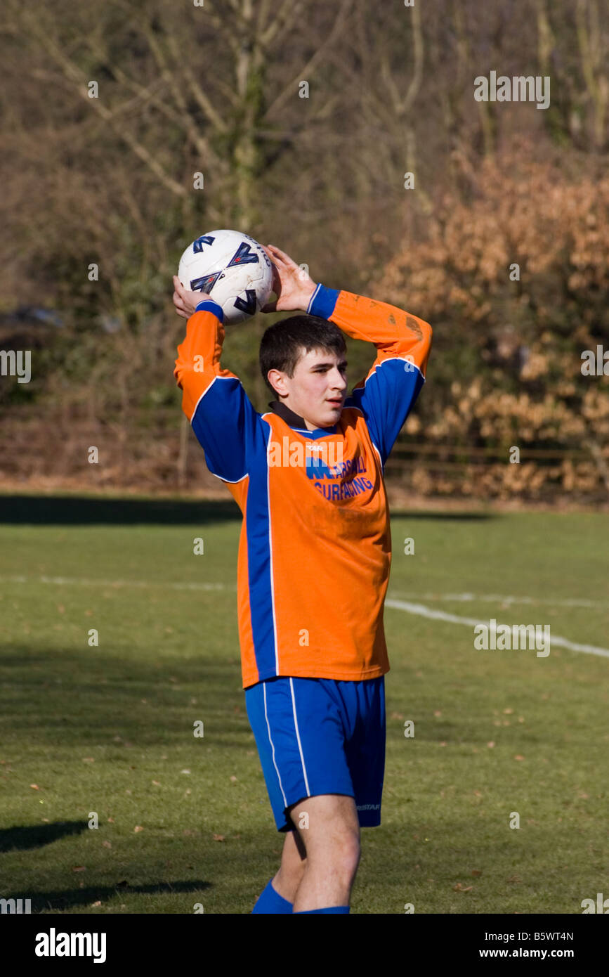 Amateur 'sunday league' Football Match Player Taking Throw In - Stock Image