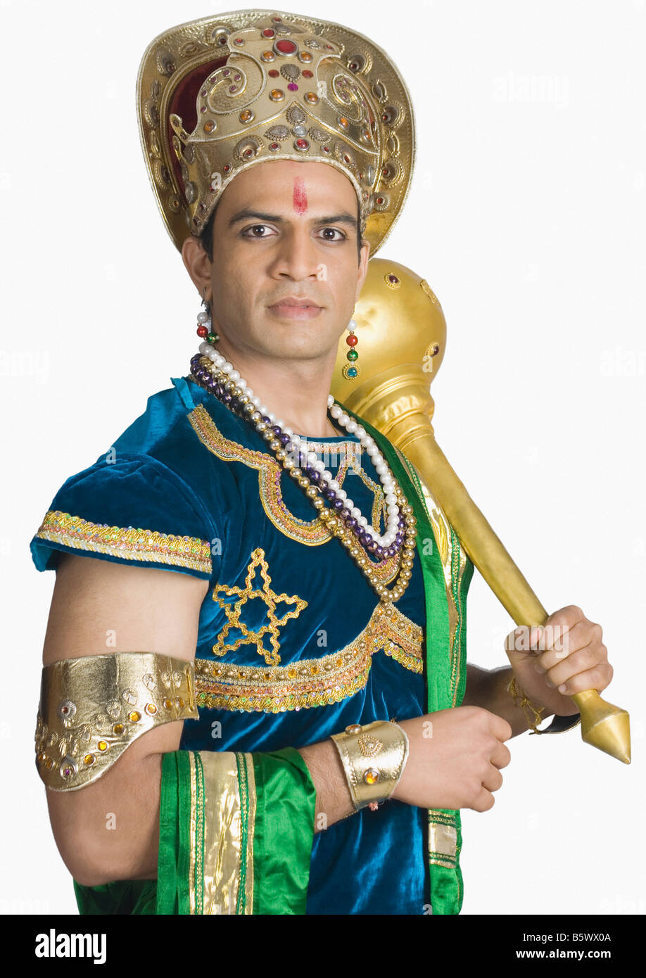 Young man dressed-up as Bhima and holding a mace - Stock Image