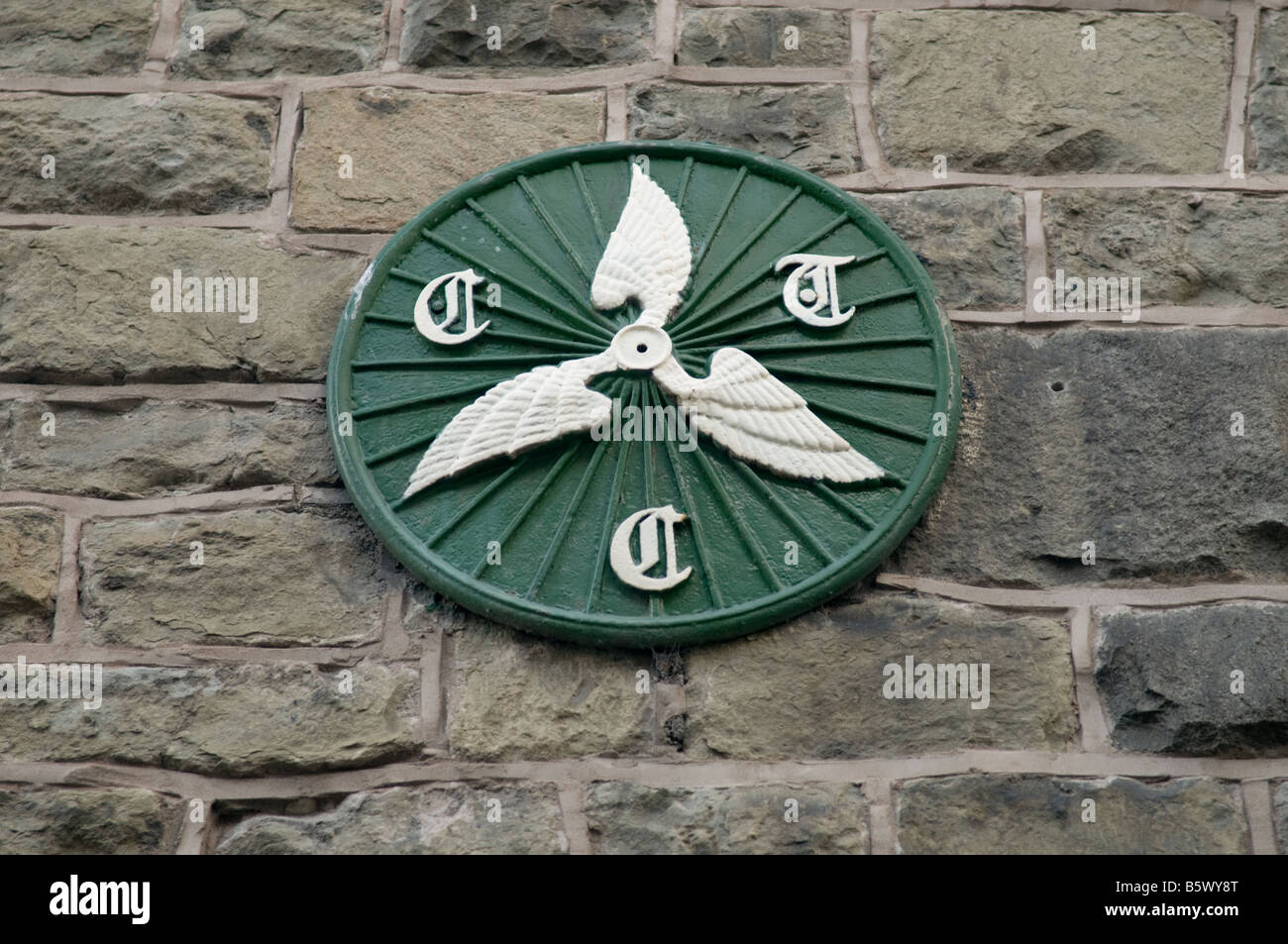 CTC Cyclists Touring Club wheeled wings green painted cast iron sign on building in Builth Wells Powys Wales UK - Stock Image
