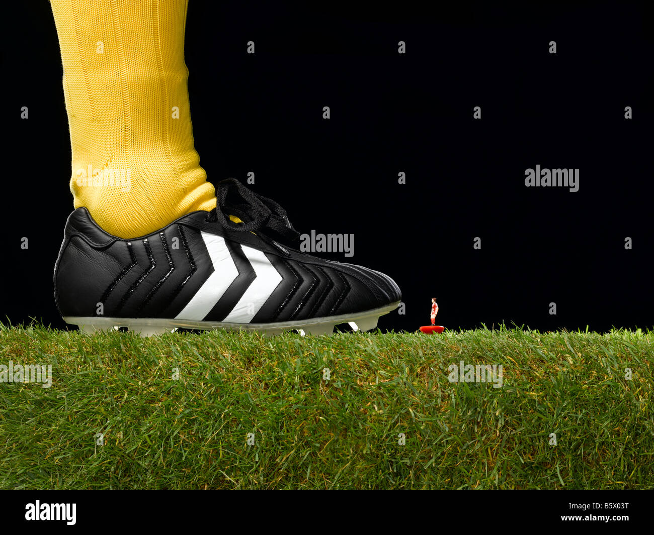 David v Goliath in a football setting, - Stock Image