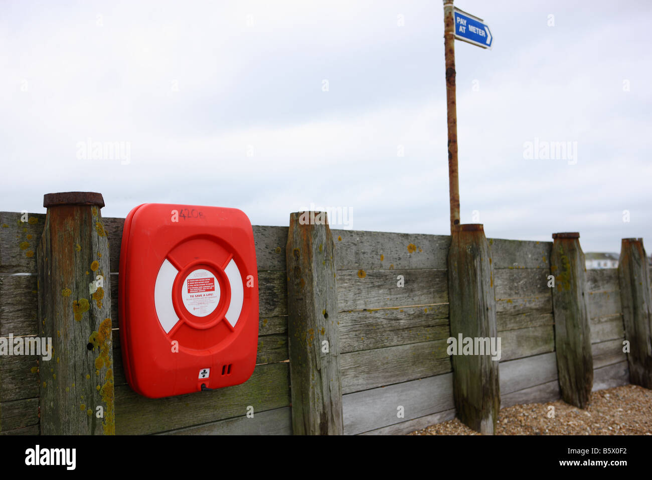 Lifebelt on the beach at Hayling Island in Hampshire, England - Stock Image