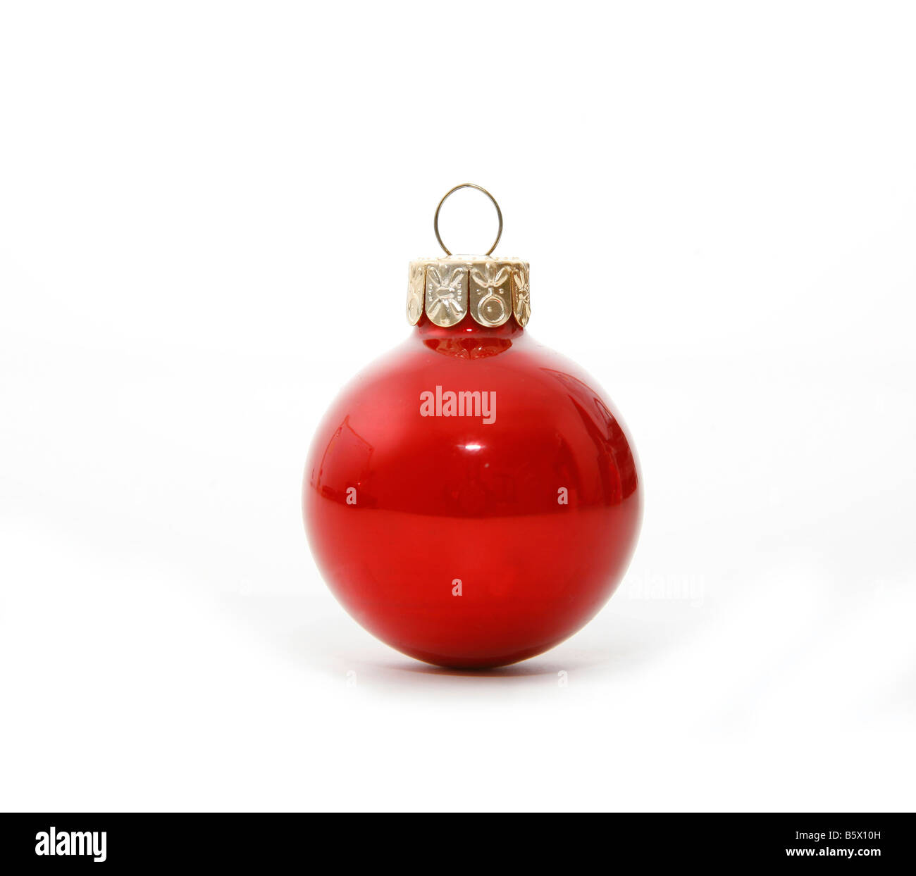 Shiney red Christmas ball decoration with drop shadow - Stock Image