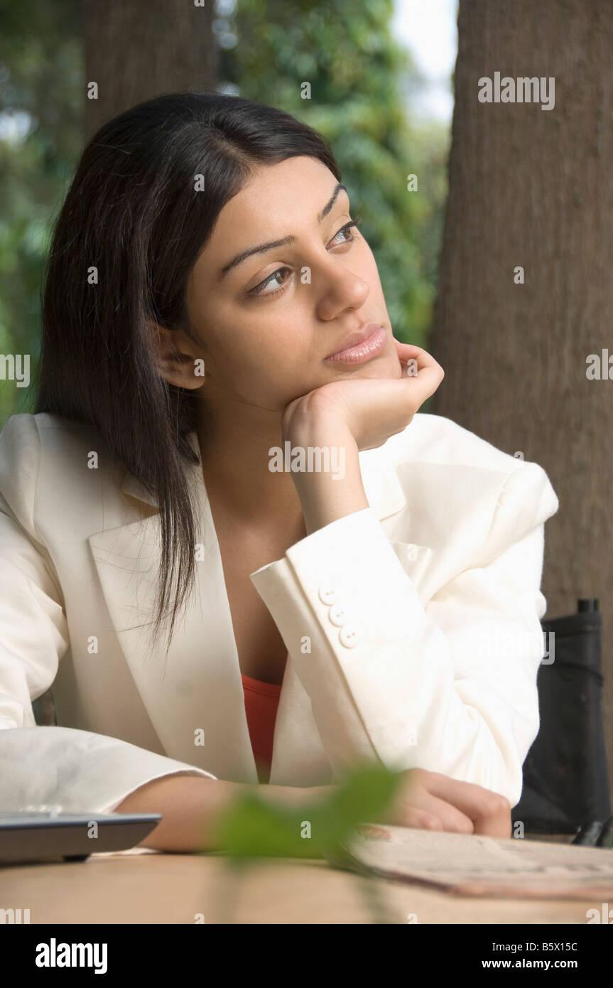 Businesswoman thinking - Stock Image