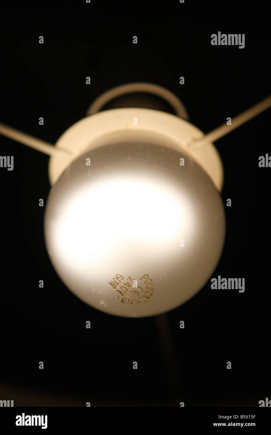 An electric light bulb swithed on - Stock Image