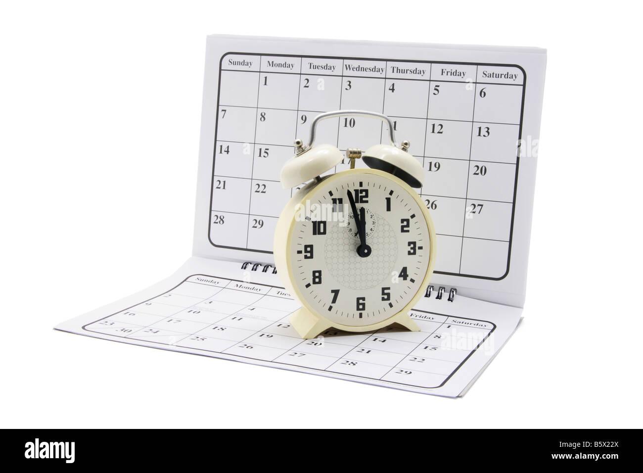 Alarm Clock on Calendar Stock Photo