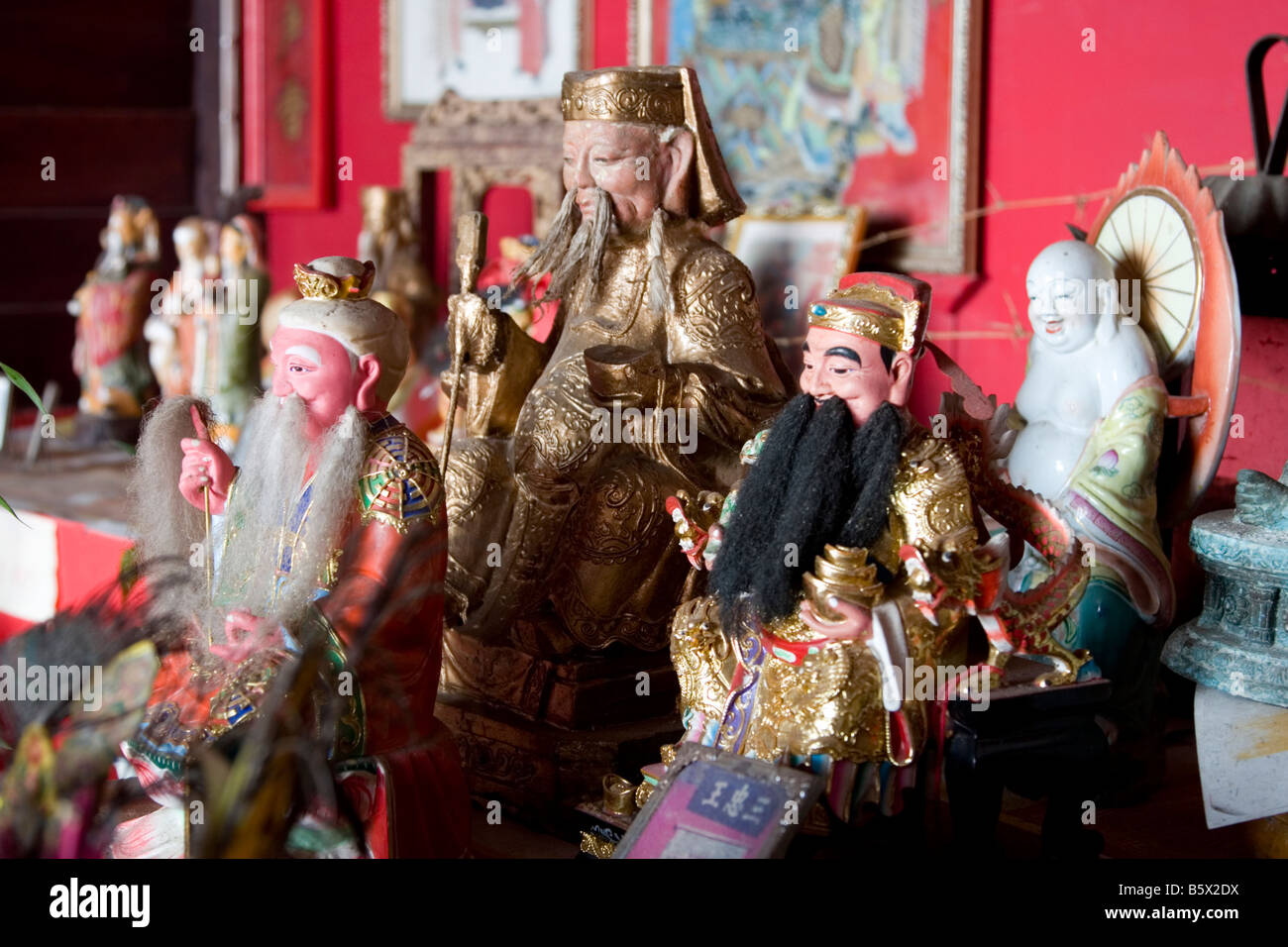 Deities at a Chinese temple in Thailand. - Stock Image