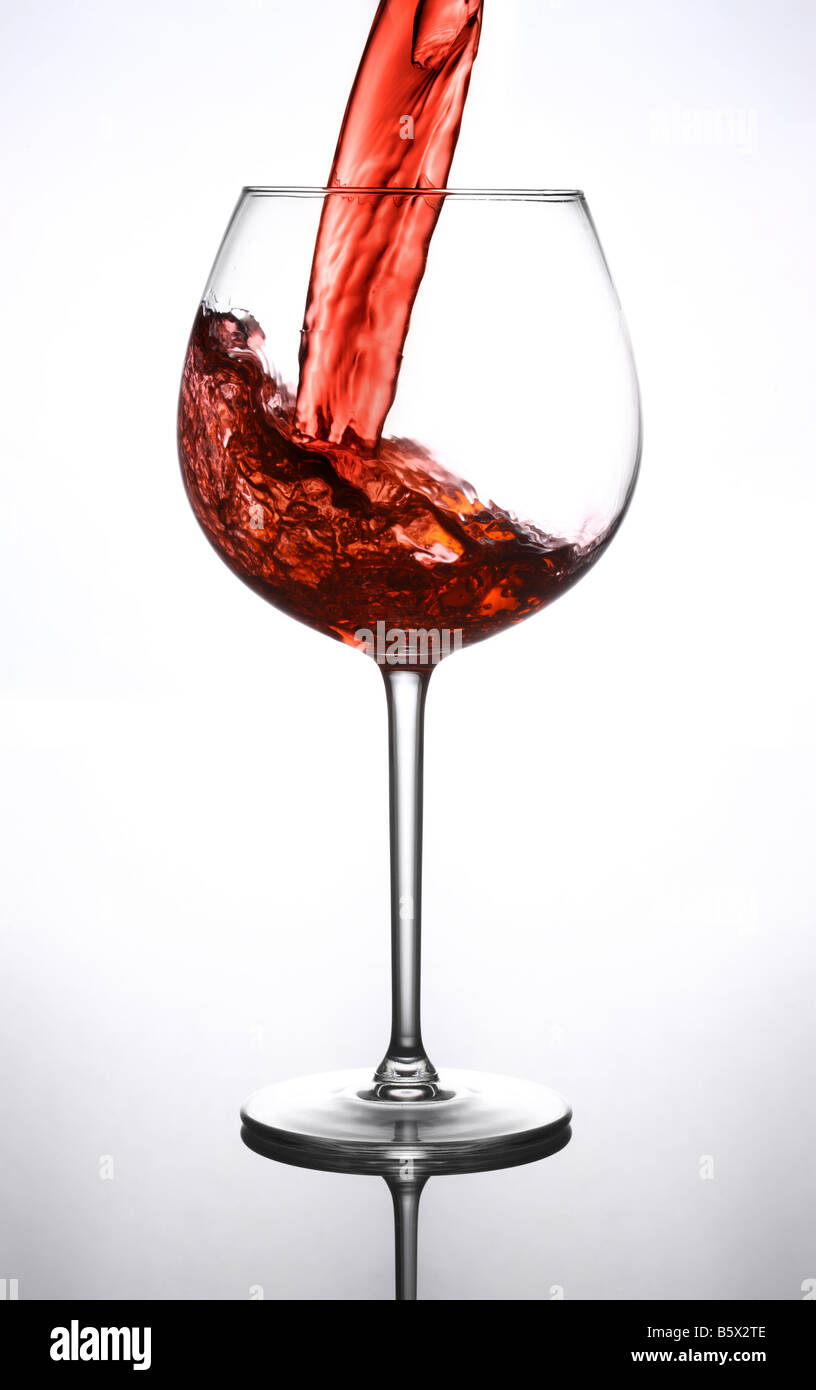 Pouring a glass of red wine - Stock Image