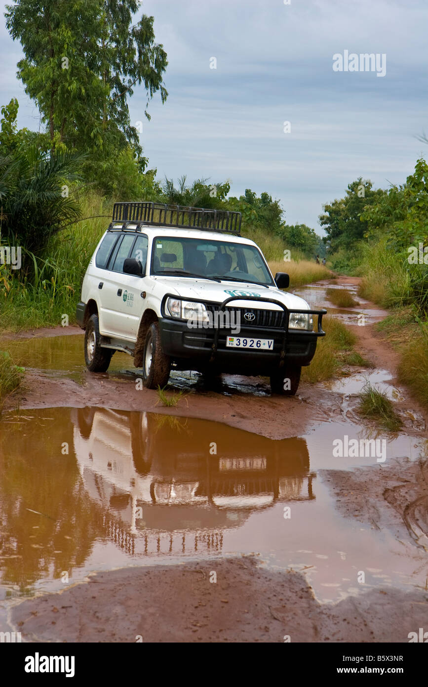 A humanitarian aid organization in Africa travels the dirt roads en route to a project visit. Stock Photo