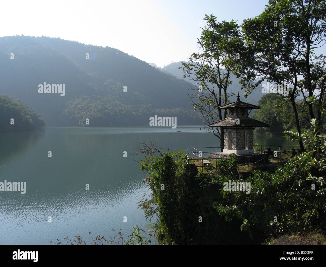 A shrine on Phewa Lake, Pokhara, Annapurna foothills, Gandaki, Himalayas, Nepal, central Asia - Stock Image