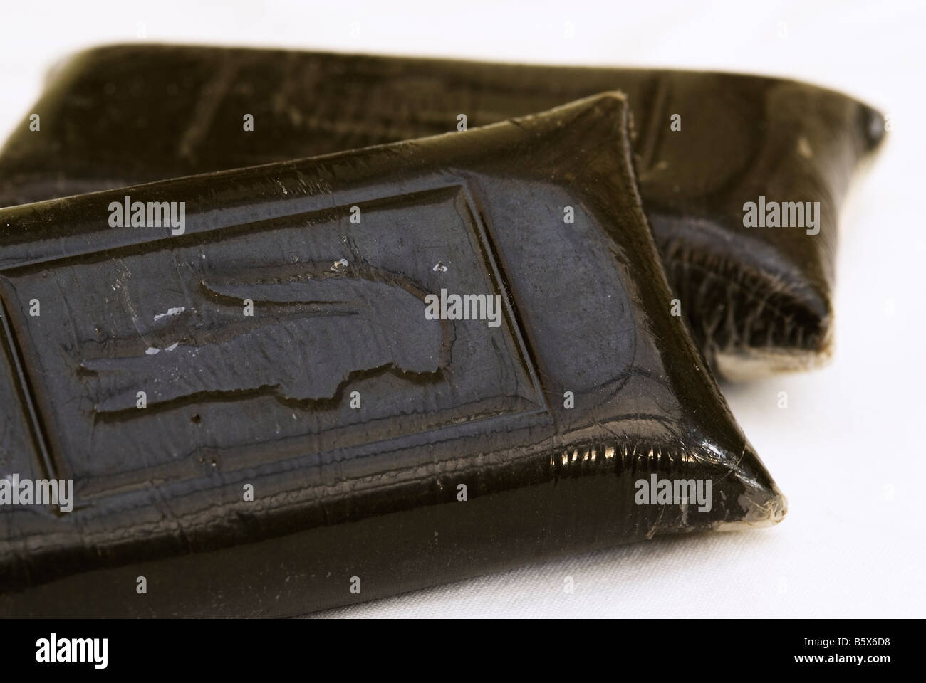 Two Nine Ounce Bars of Soapbar Hashish Embossed with Alligator Lacoste Logo - Stock Image