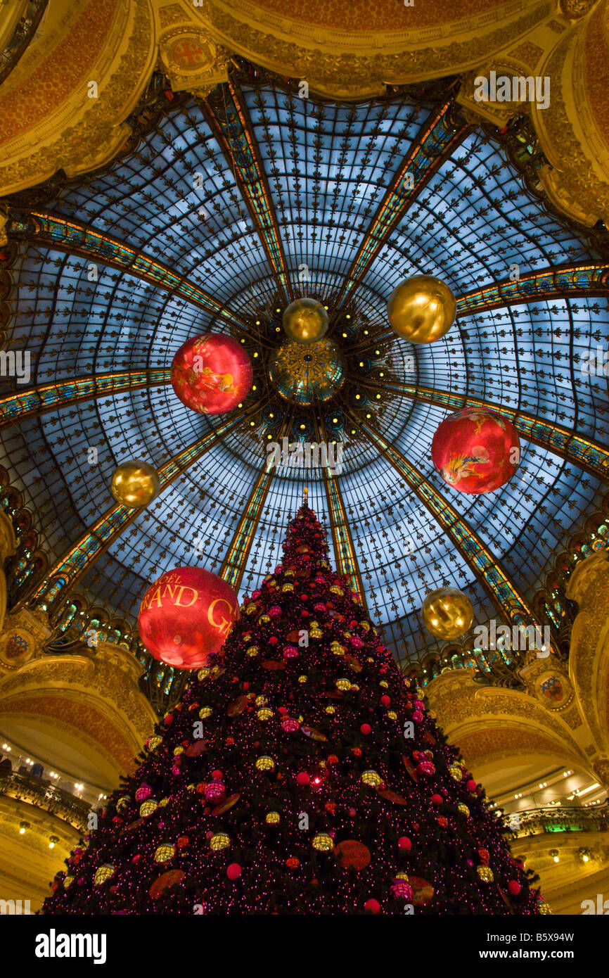 Christmas tree under the domed glass roof of department store Galeries Lafayette 2008 Paris France - Stock Image