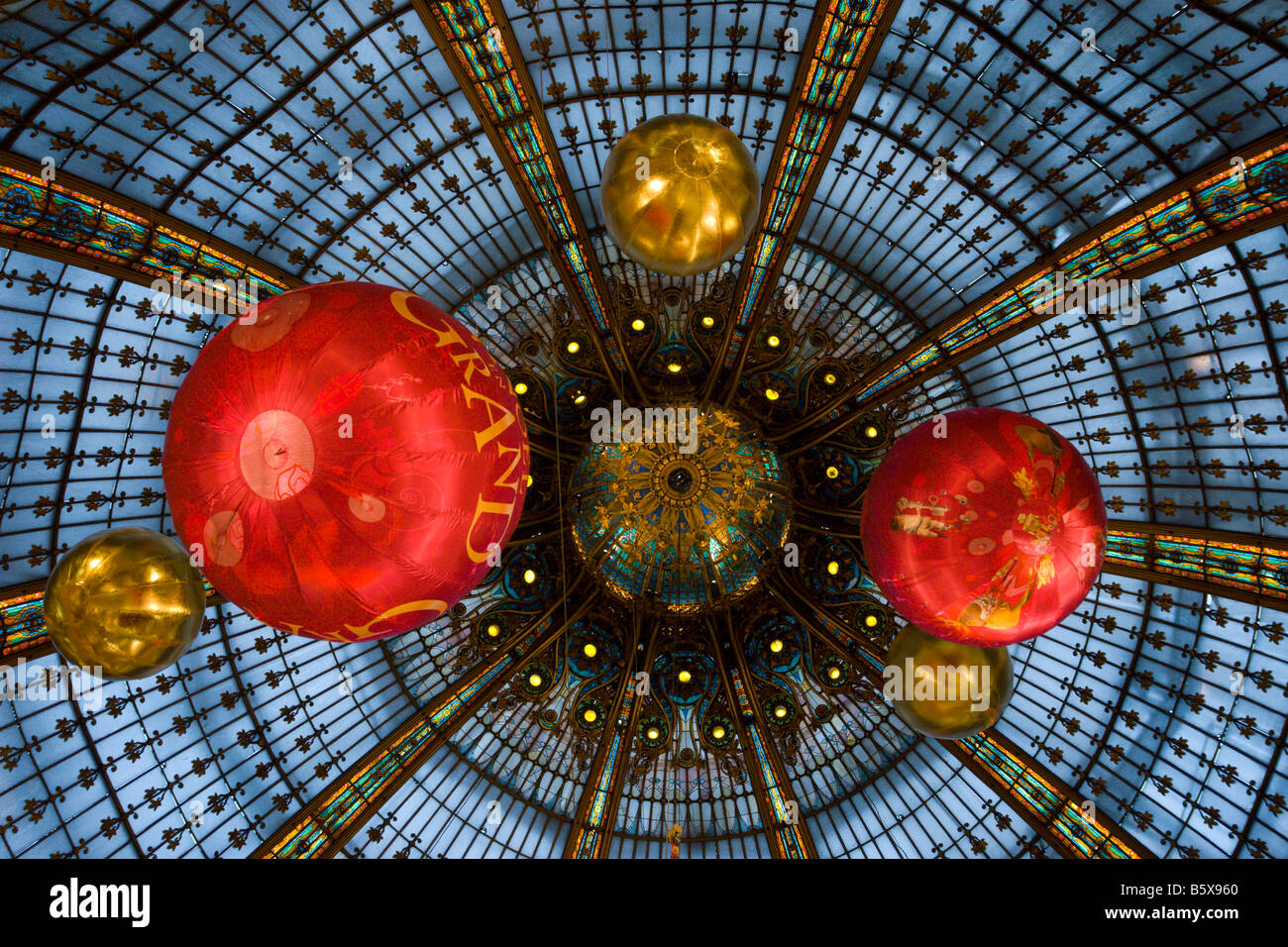 Department store Galeries Lafayette Paris France glass dome roof and Christmas decorations 2008 - Stock Image