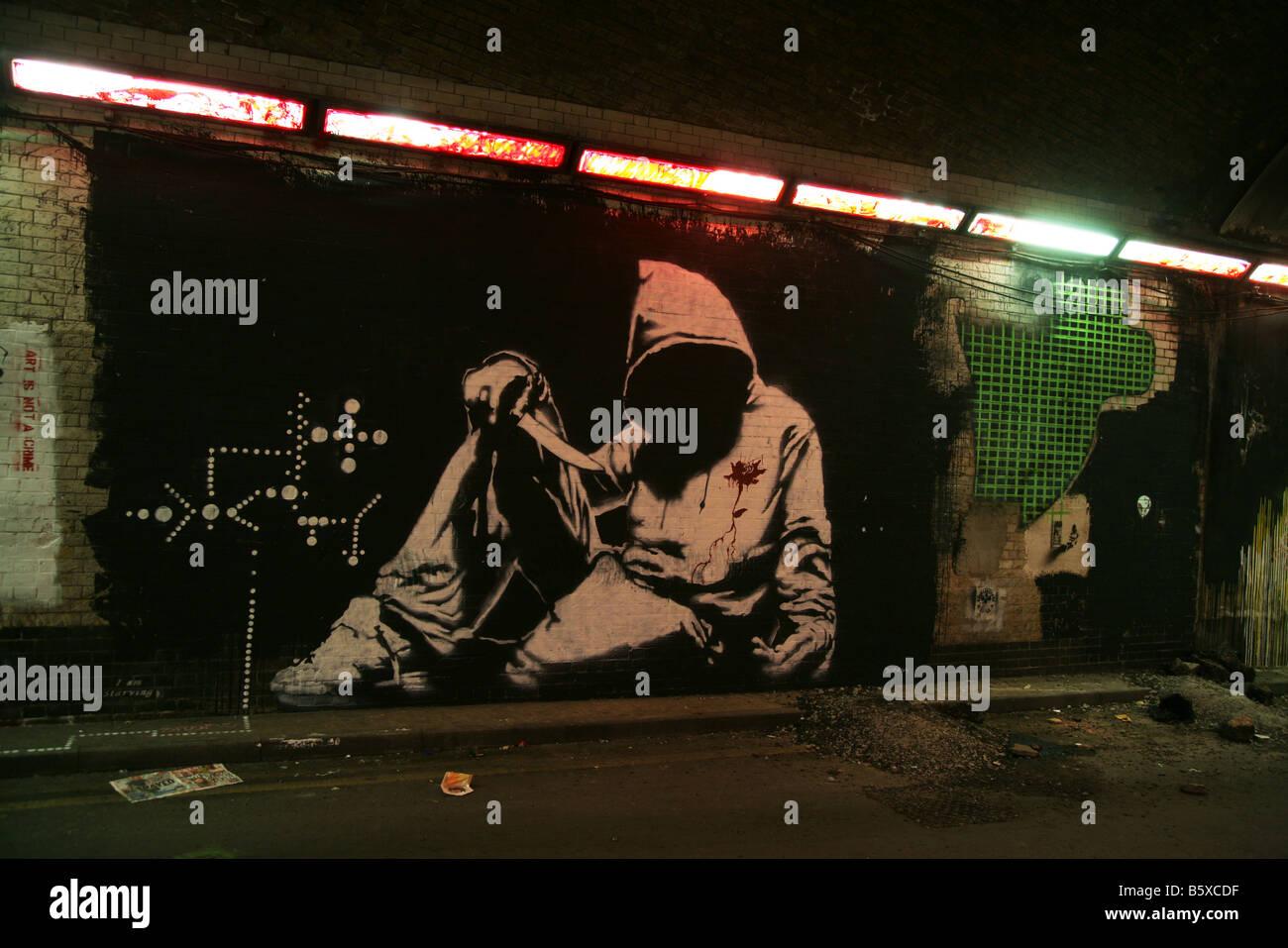 knife crime hoody hoodie Banksy graffiti artist art - Stock Image