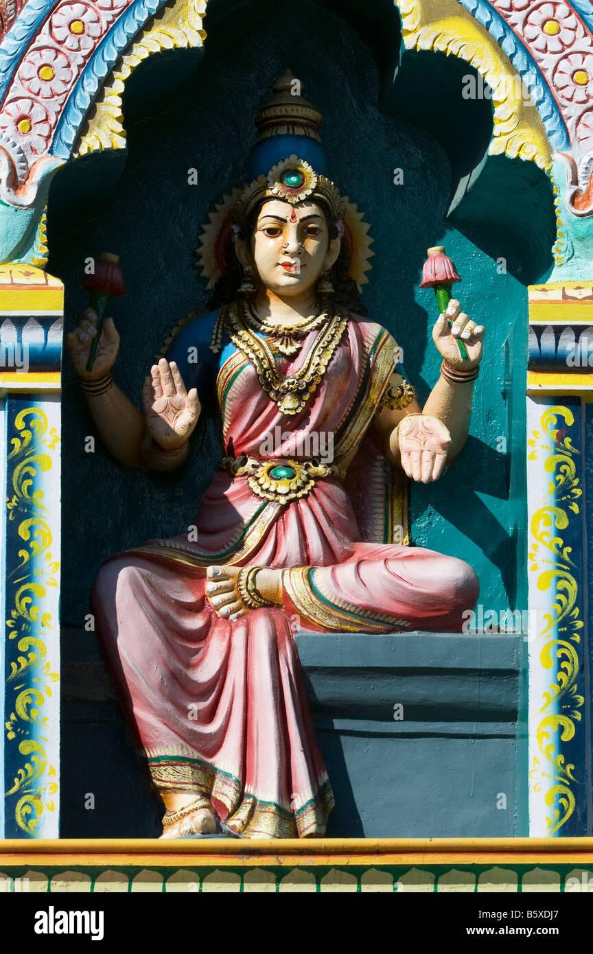 Hindu deity, painted statue, on the Lord Lakshmi Narasimha Swamy Temple in Kadiri, Andhra Pradesh, India - Stock Image