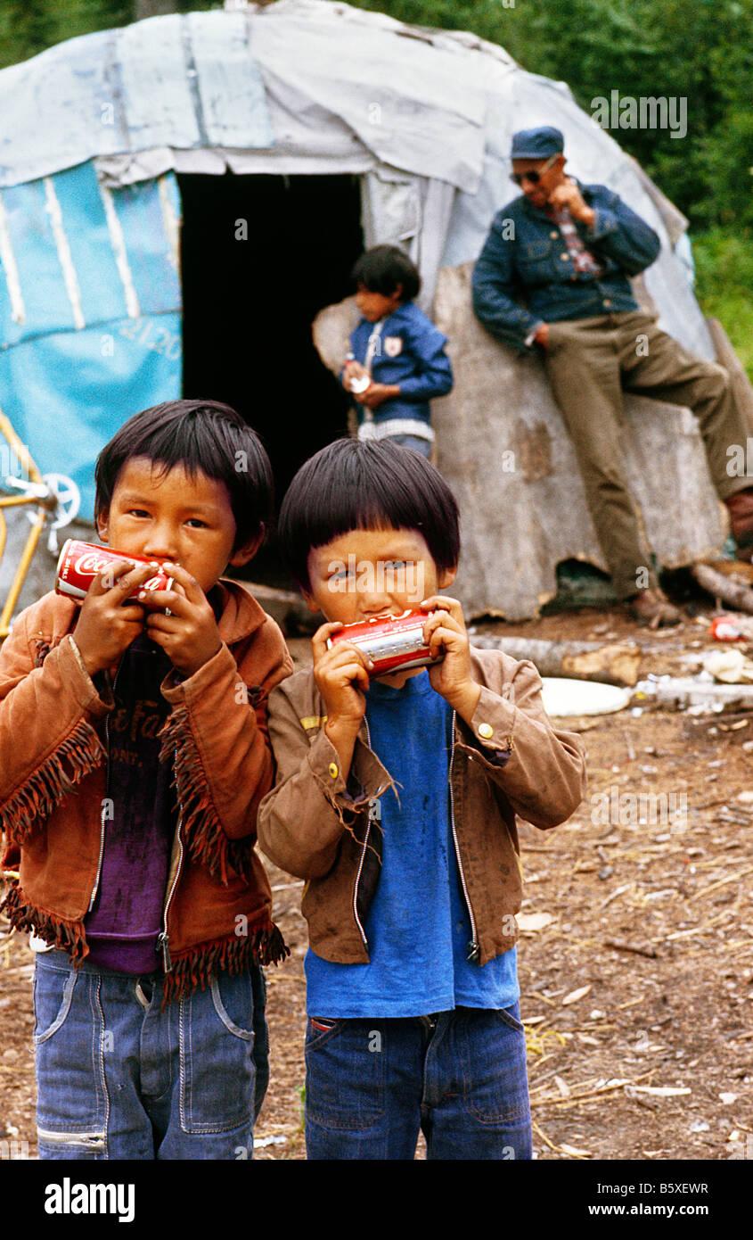 Native American Aboriginal Indian Children holding tins of ...