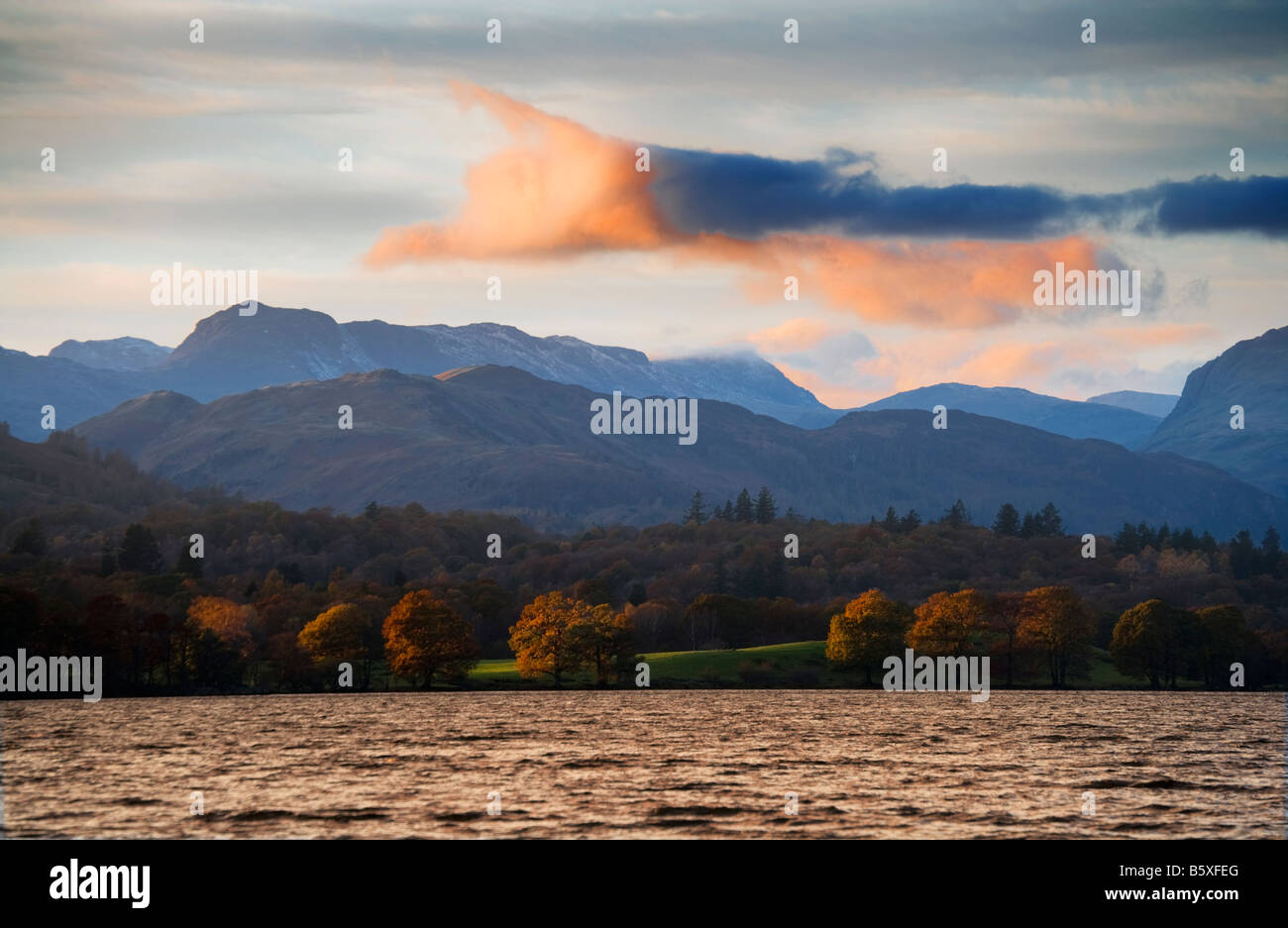 Sunset over Windermere in the Lake District Cumbria England UK with the Langdale Pikes in the distance. - Stock Image