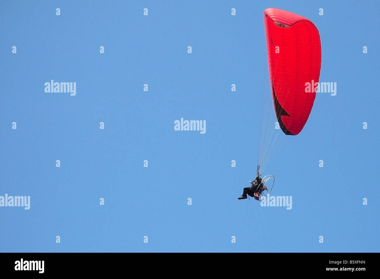 A parachutist flew in the clear sky - Stock Image