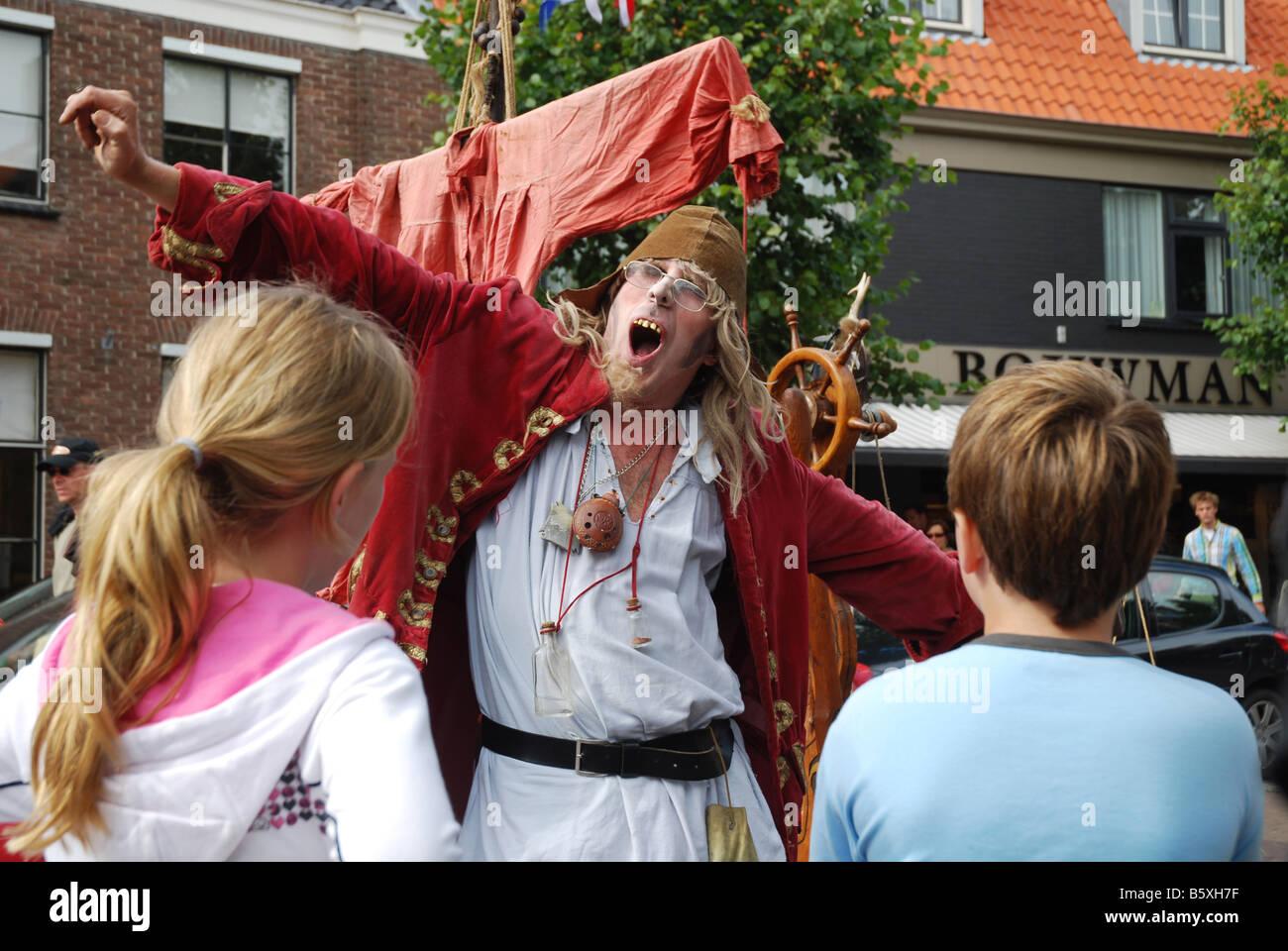 street artist performing his routine Domburg Zeeland Netherlands - Stock Image