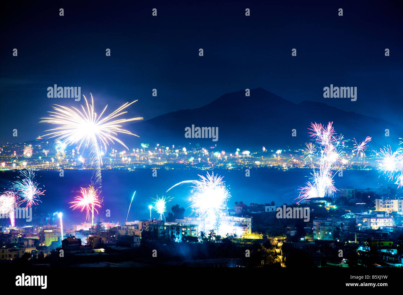 Fireworks light up Naples in celebration of the New Year - Stock Image