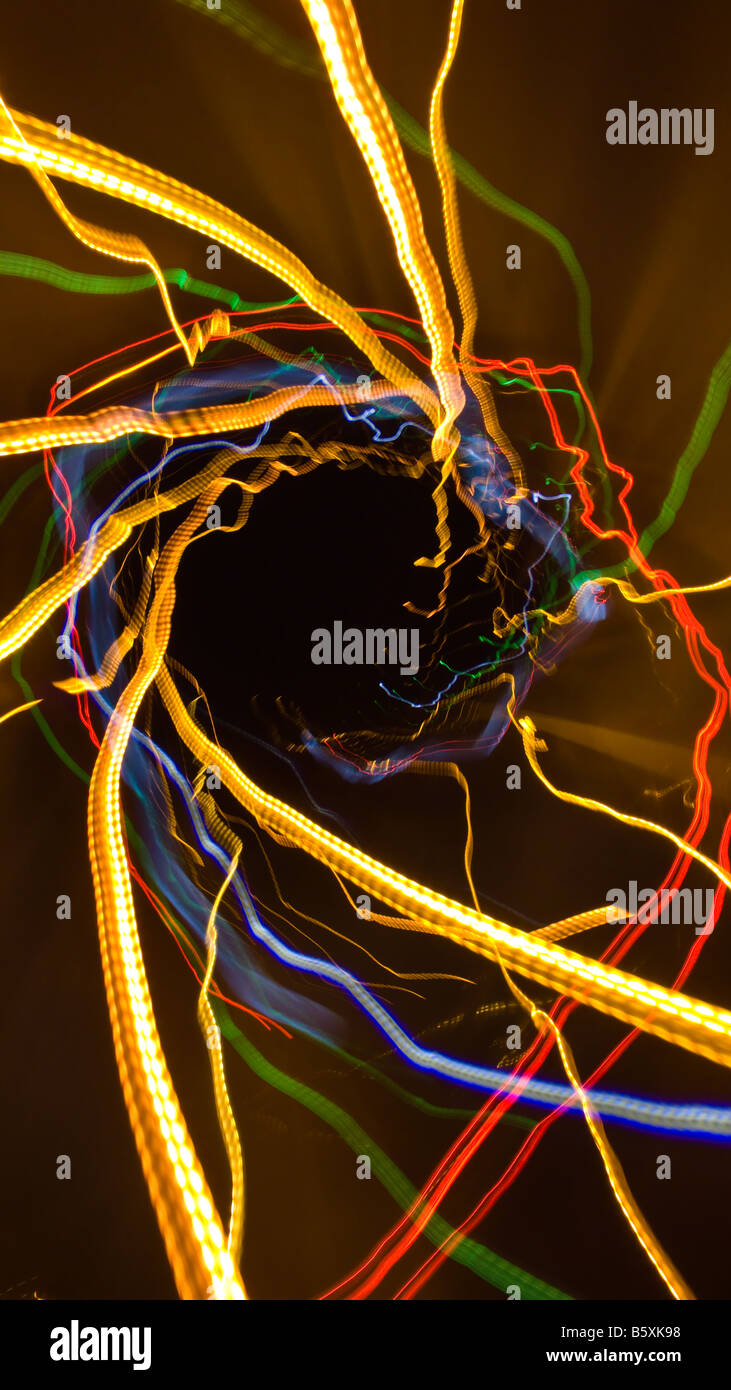 On the Road -- Abstract and dynamic traffic lights at night, seen by either a rolling over car or a drunken driver. - Stock Image