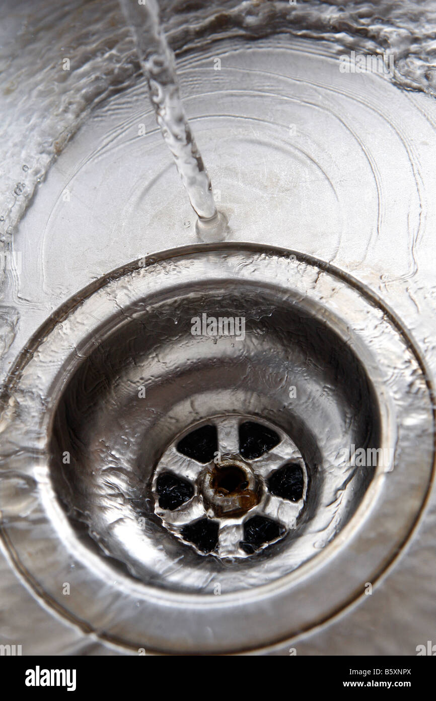 A plug hole in a domestic stainless steel sink - Stock Image