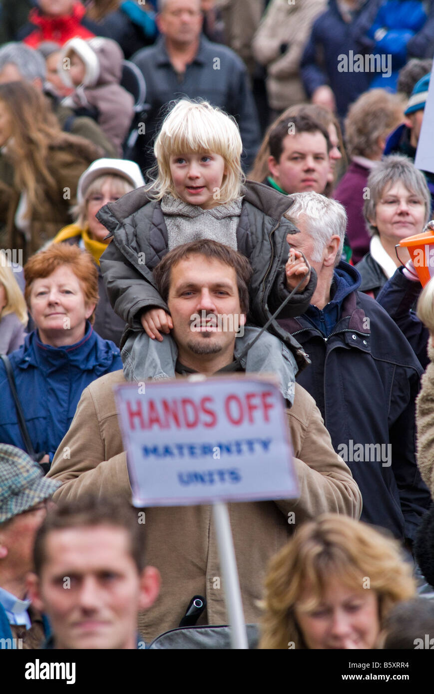 UNITED KINGDOM, ENGLAND, 17th November 2007. A man carries a child at a rally opposed to hospital cuts. - Stock Image