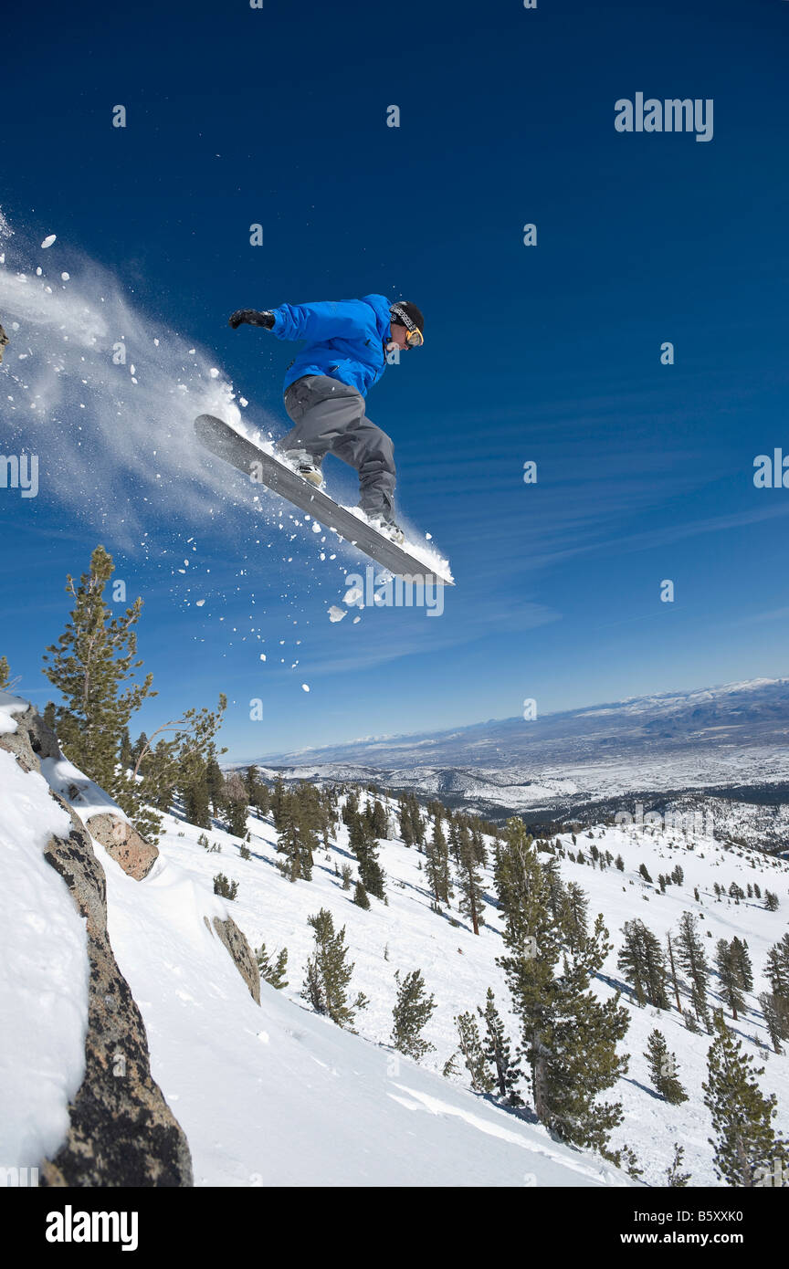 Peter Spain jumps a cliff on a Bluebird day at Mt Rose Ski Tahoe Stock Photo