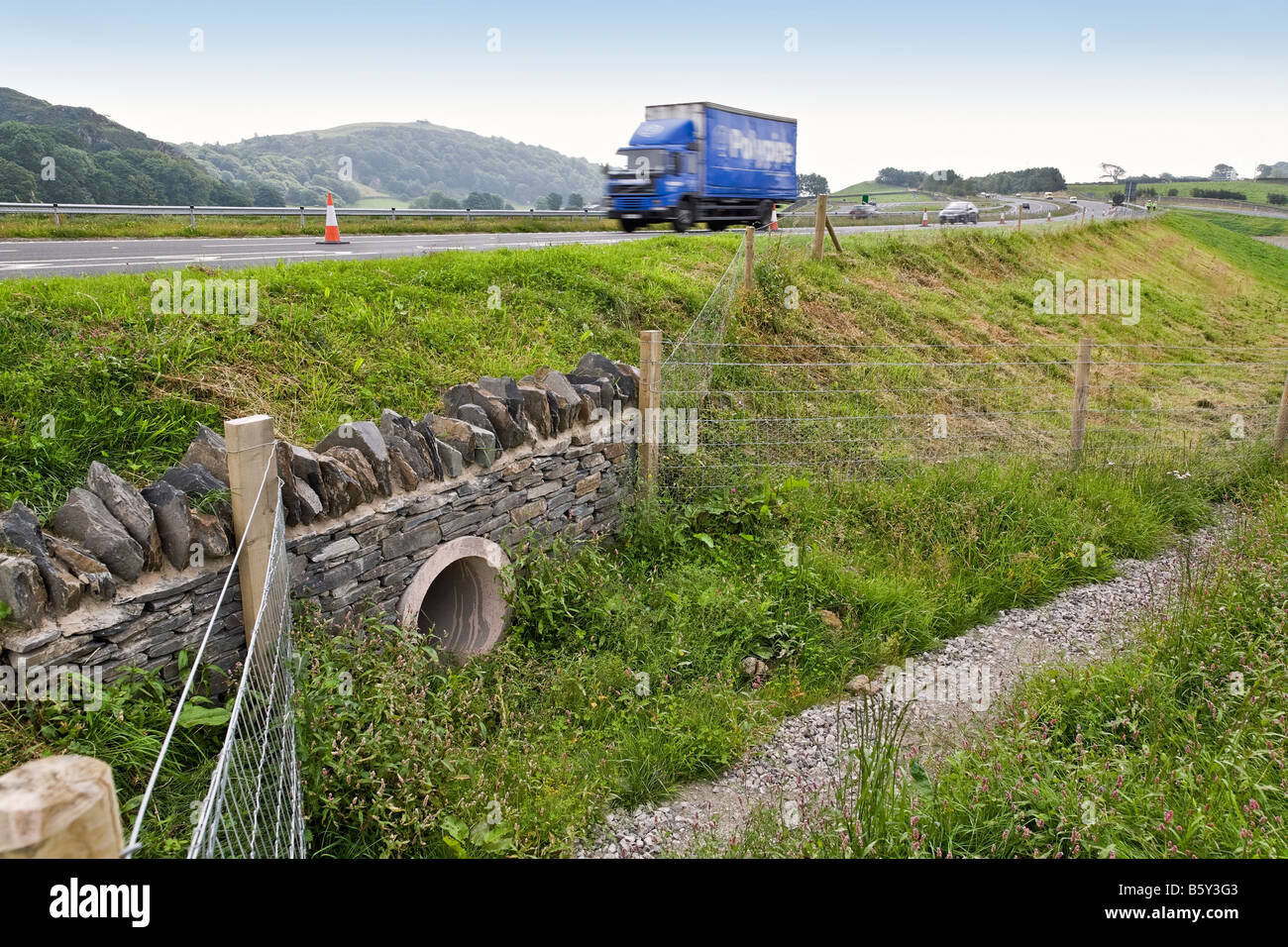Badger tunnel under the A590 dual carriageway in Cumbria Stock Photo