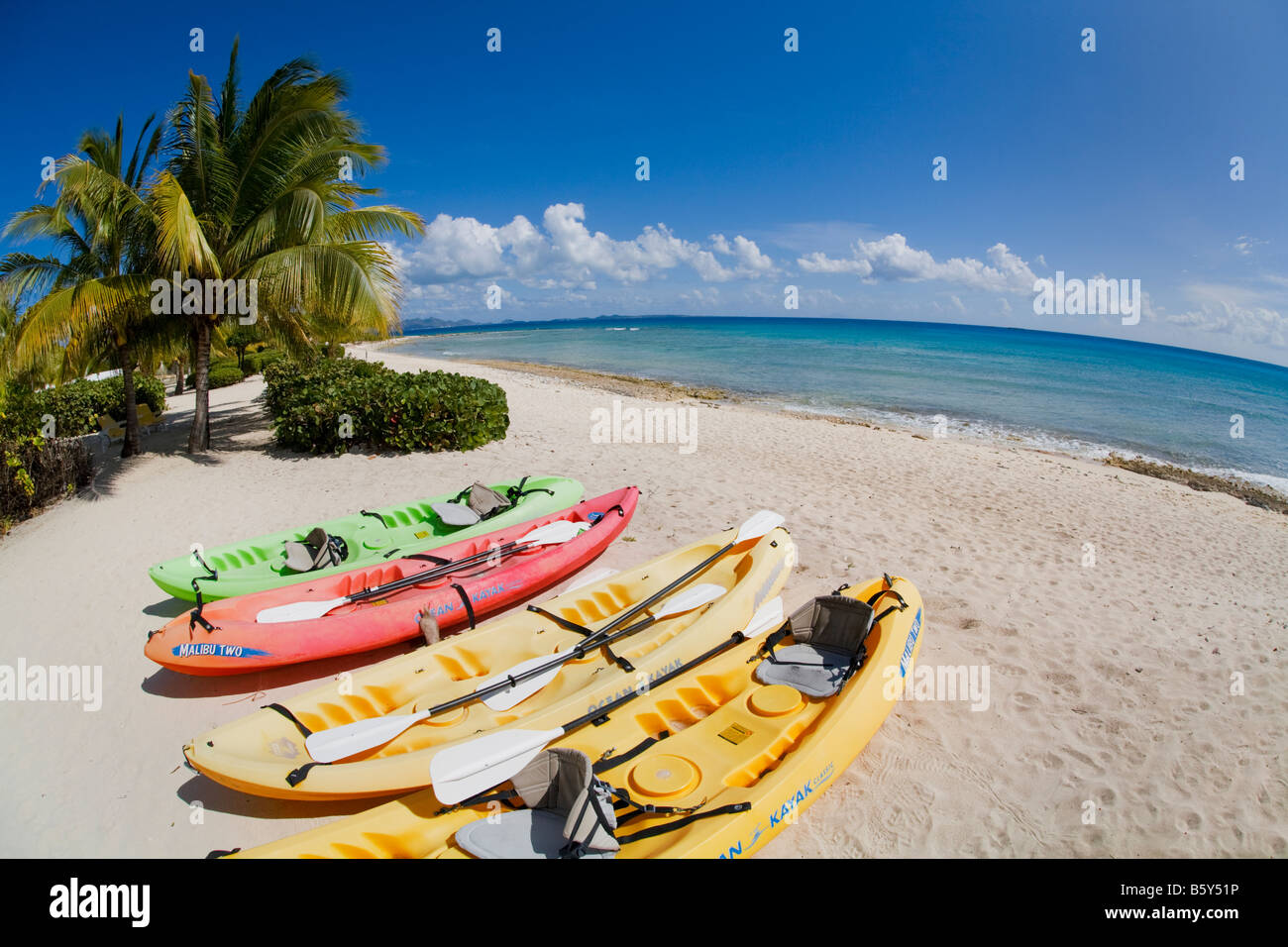 Ocean kayaks on Shoal Bay West beach on the caribbean island of Anguilla in the British West Indies Stock Photo