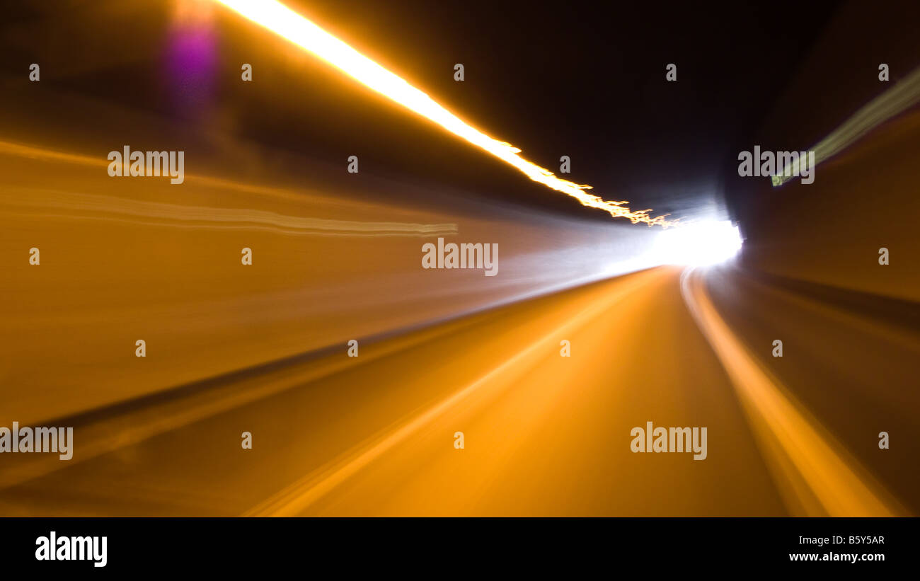 On the road -- Speedy and dynamic drive, seeing the light at the end of the tunnel. Stock Photo