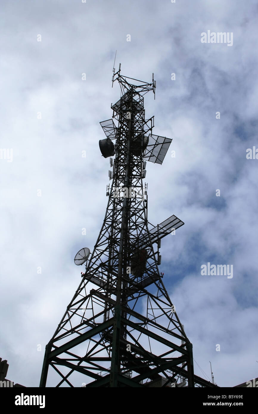 Older-style cell and communications tower - Stock Image