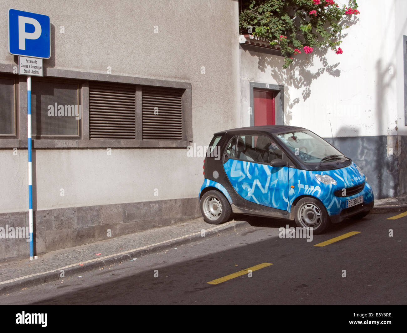 Small parked car and a parking sign at Ponta Delgada, São Miguel, Azores, Portugal - Stock Image