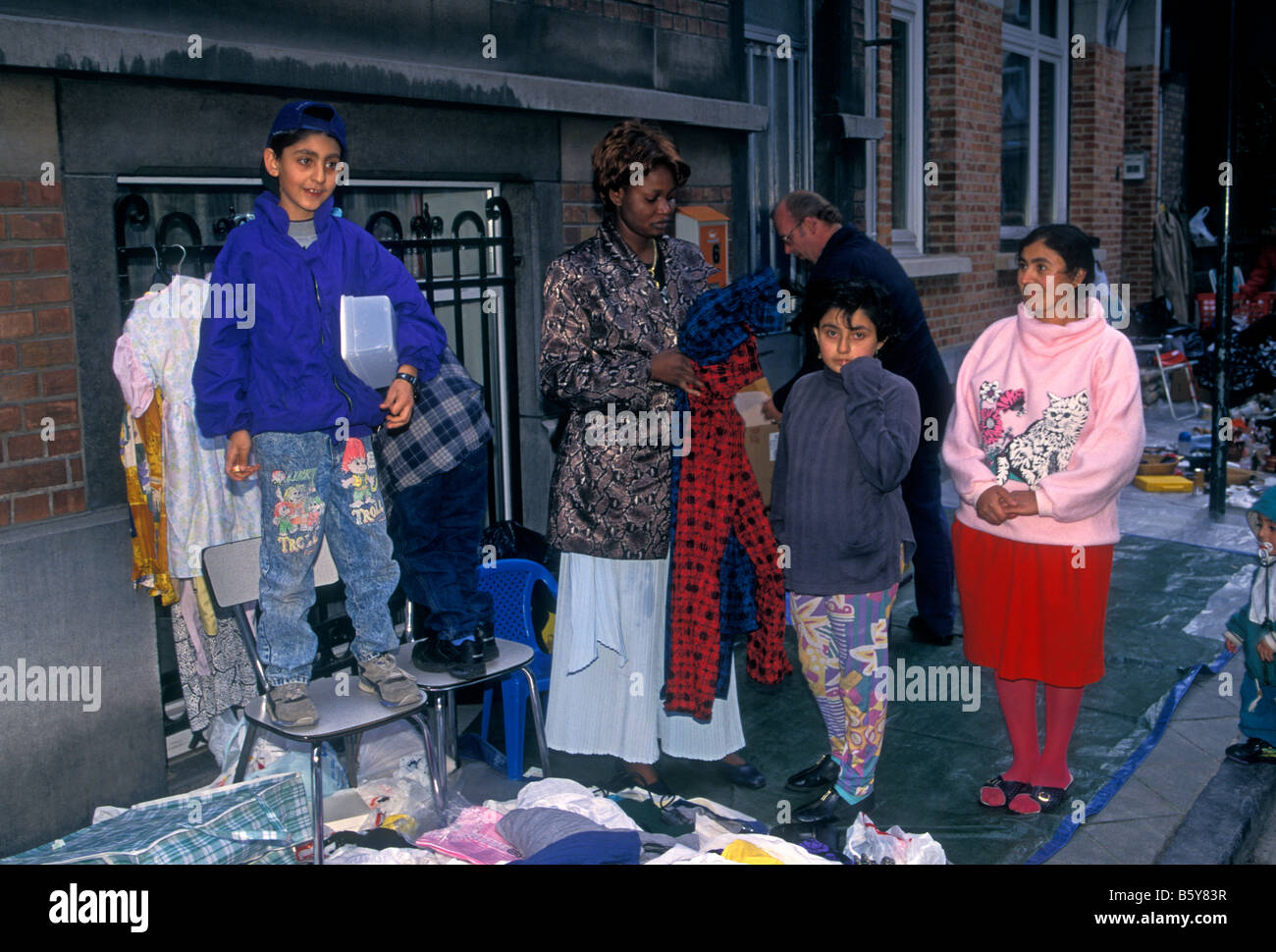 people, immigrant, immigrants, immigrant community, refugees, migrants, flea market, city of Brussels, Brussels Stock Photo