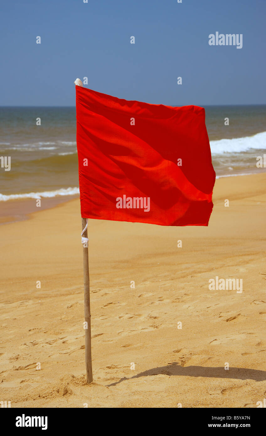 Red Danger Flag at Candolim Beach, Goa, India - Stock Image