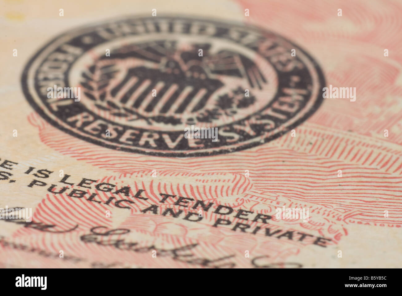 Close-up of seal and the words 'legal tender' and 'public and private' on front of American ten - Stock Image