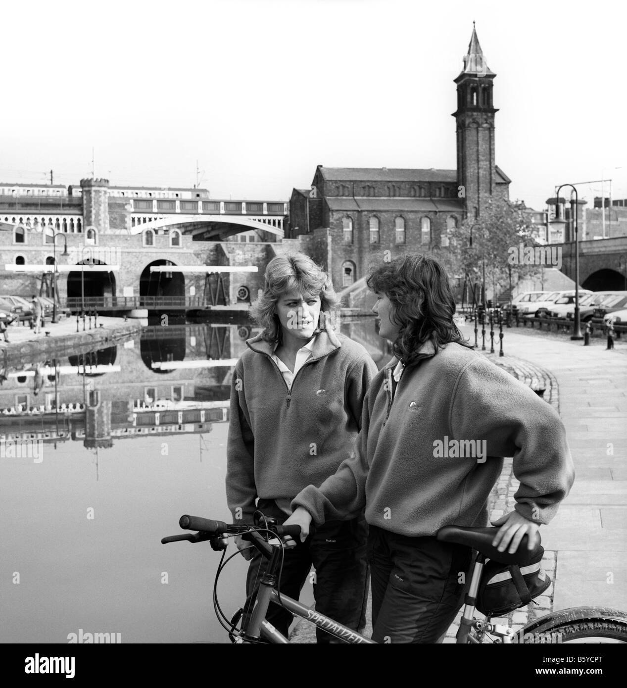 UK England Manchester city centre Castlefield Rangers patrolling Bridgewater Canal on bicycles - Stock Image