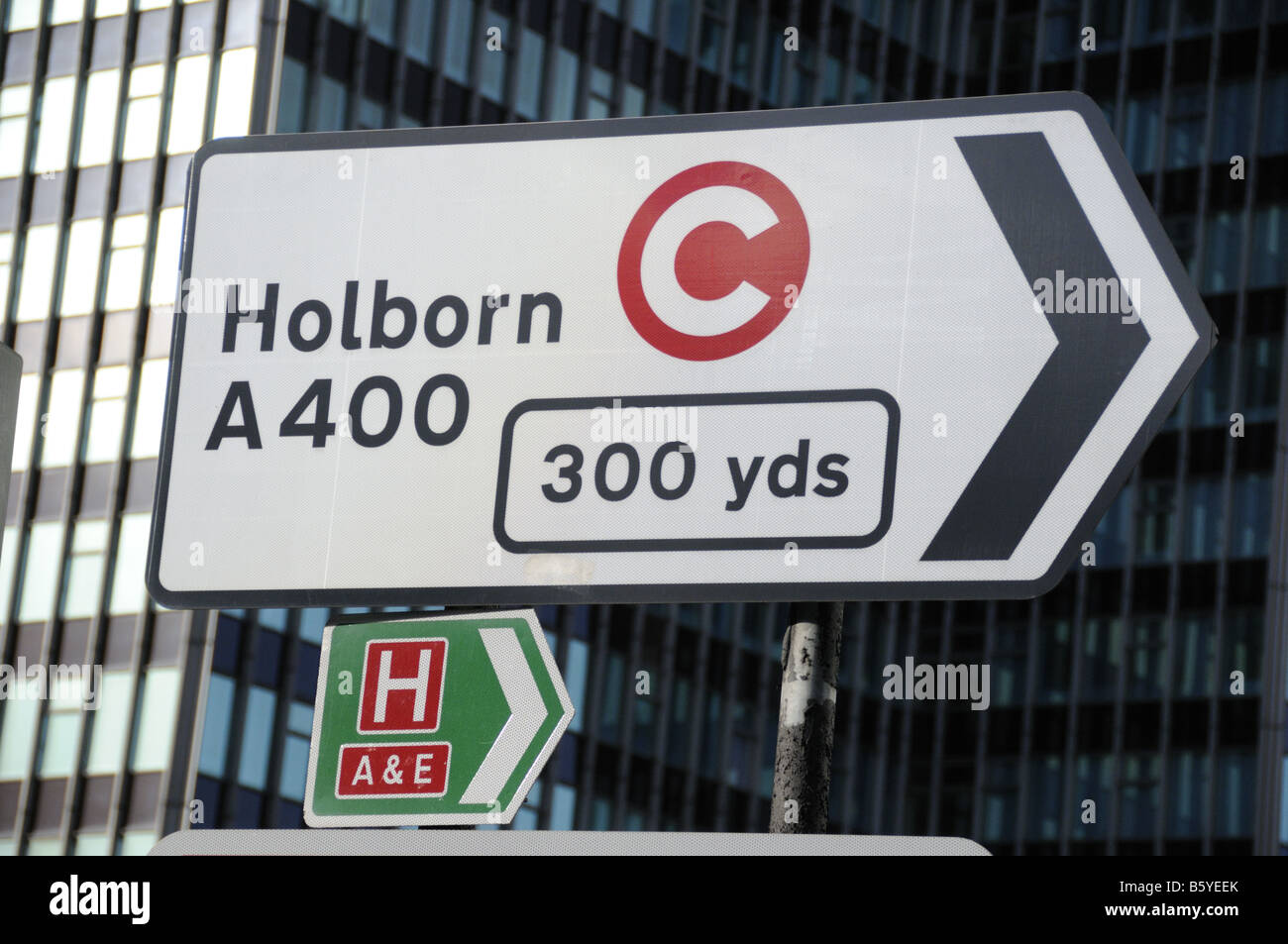 Direction sign to Holborn with congestion charge logo London England UK - Stock Image
