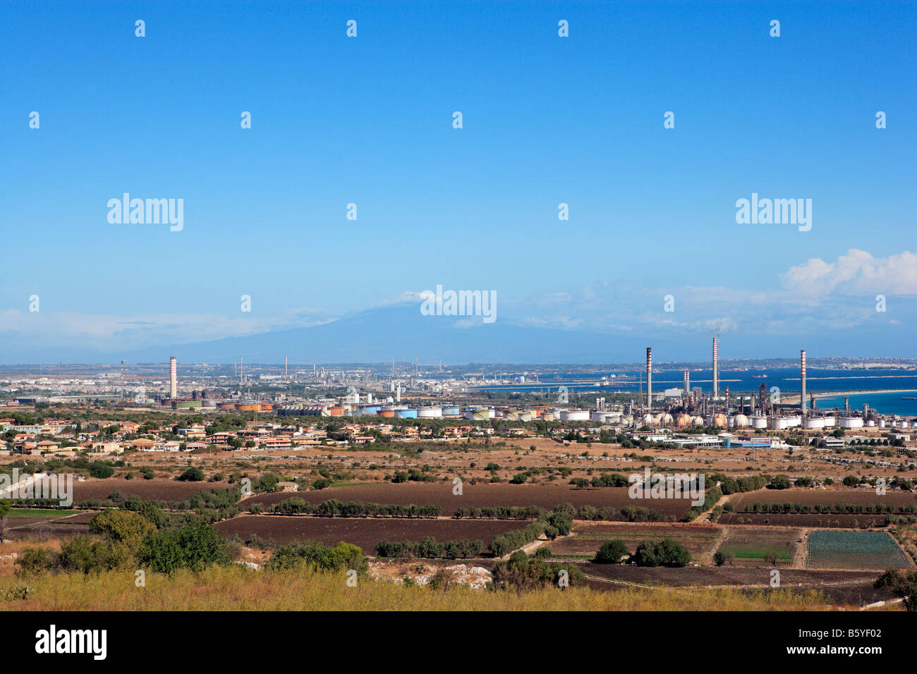 Oil Refineries, Petro-Chemical Industry and Mount Etna, Sicily - Stock Image