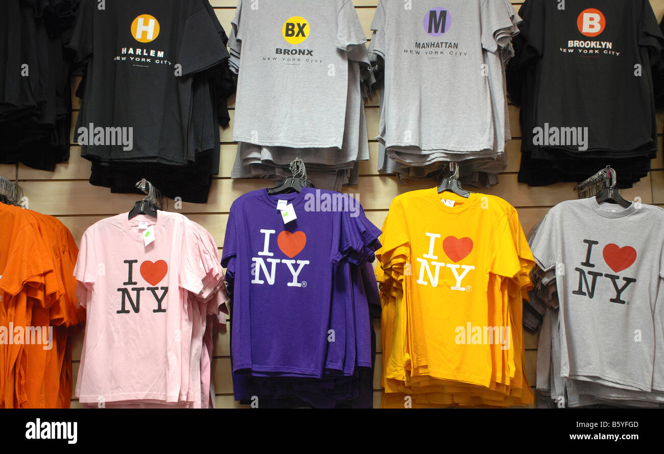 T shirts on a rack in a New York City shop - Stock Image