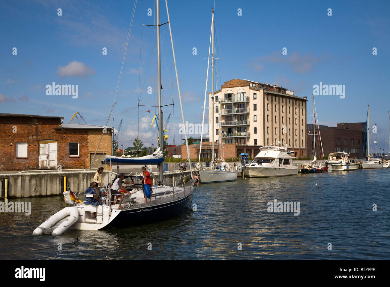 Yacht in harbour Wismar Germany - Stock Image