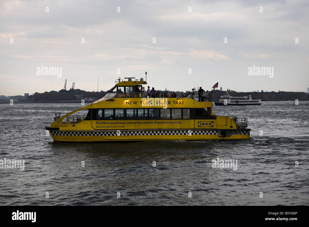 Water taxi on the Hudson River near Battery Park, Manhattan, New York City USA - Stock Image