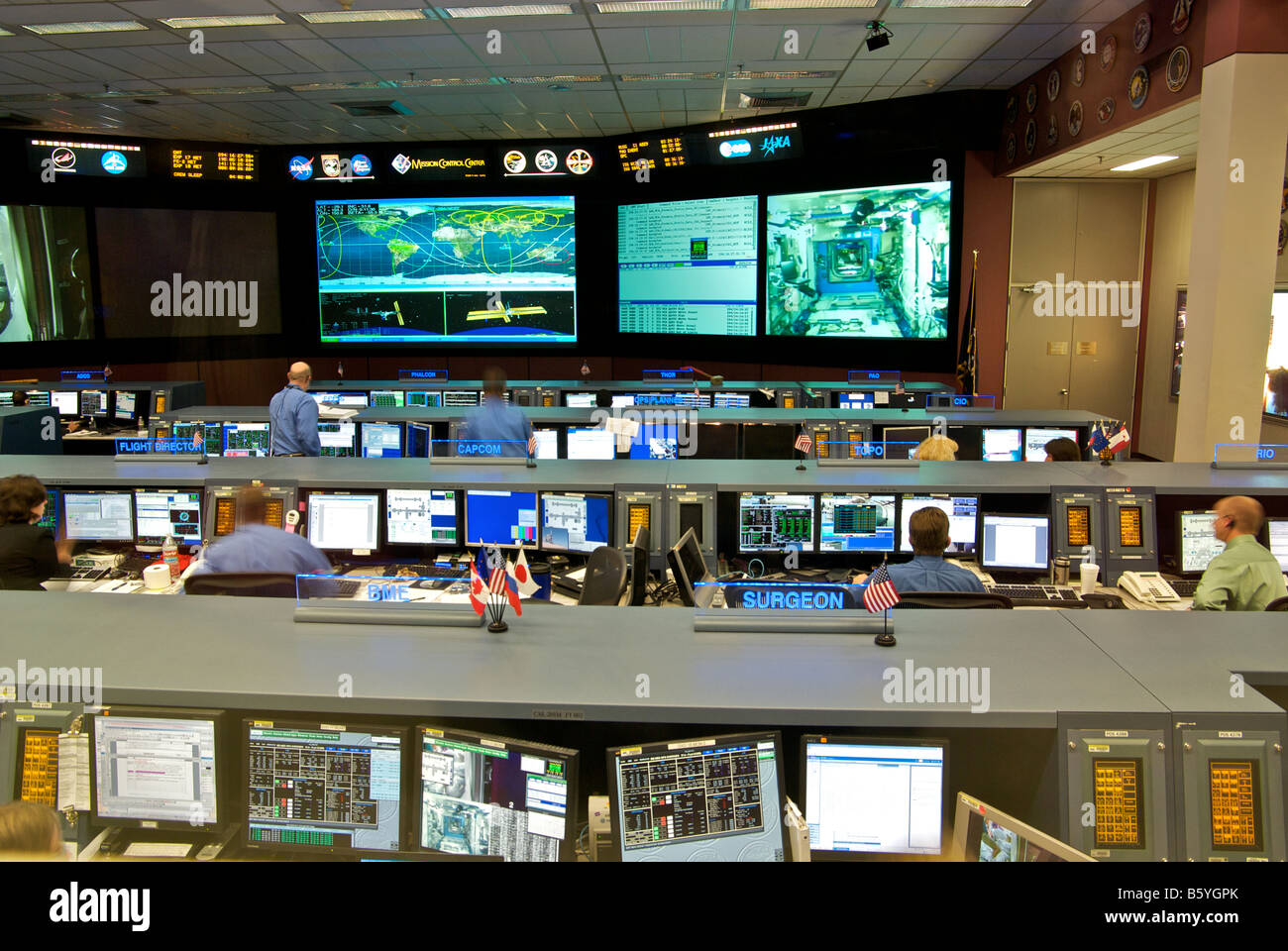 Ground controllers working in the new state of the art NASA Mission Control Center at the Johnson Space Center - Stock Image
